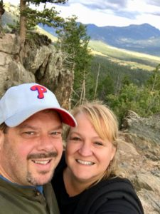 couple selfie in front of mountains