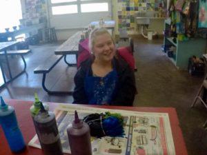 Girls smiling at tie dye table