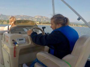 girl driving a pontoon